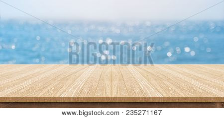 Empty Plank Wood Table Top With Blur Blue Sky And Sea Boekh Background,mock Up Template For Display