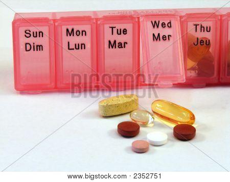 Bilingual Pill Organizer On White Background