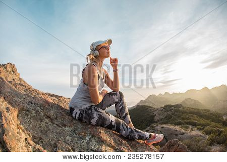 Music Lover At The Peak Of The Huge Mountain, Outdoor Leisure Quality Time, Pensive Look.