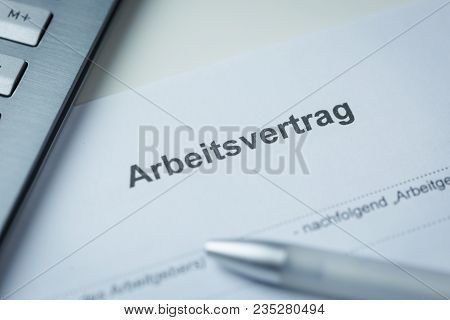 Blank German Arbeitsvertrag Or Employment Contract With A Pen On A Desk Ready To Be Completed After