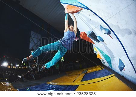 Woman Climber On The Climbing Competition. Woman Makes Very Hard Dynamic Move With Jumping. Woman Cl