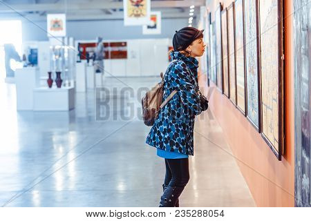 Novokuzneck, Russia - 09.04.2018: Young Woman Looking At Modern Painting In Art Gallery