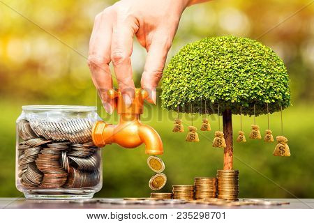 Woman's Hand Open A Faucet Of Jar And Gold Coin Drop For Invest Benefit Growing And Tree Of Money Ba