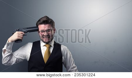 Young lost businessman man shooting his head with gun