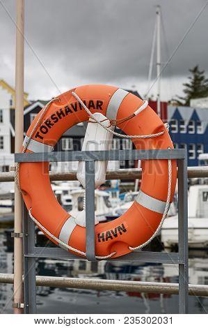 Lifering In Port Area With Name Of Town Of Torshavn, Faroe Islands, Denmark Written On It.