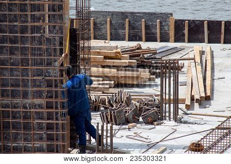 Construction Workers Working On Cement Formwork Frames. Construction Of A New Building.