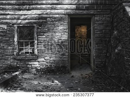 Exterior Of An Old Abandoned Grist Mill.