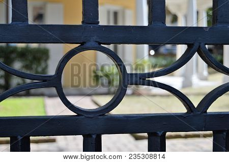 Wrought Iron Gate In Front Of Home