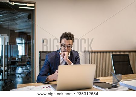Man Professional Ceo Dressed In Luxury Official Suit Working On Laptop Computer While Sitting In Off