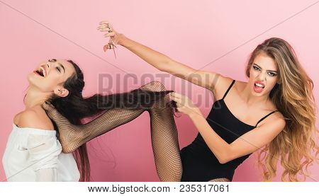Sexy Women With Long Hair, Lesbian. Women With Scissors Cut Hair On Pink Background. Friends At Hair
