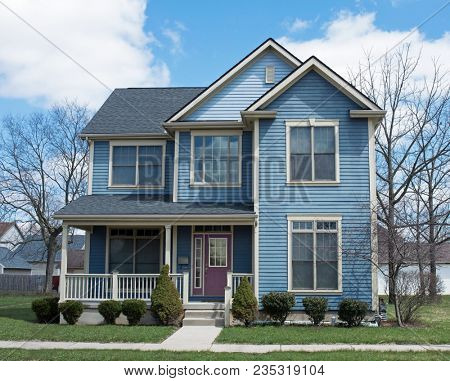 Blue Two Story House with Purple Door