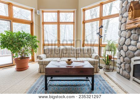 Upscale Living Room.  Inviting Scene With Lots Of Windows And Modern Decor.