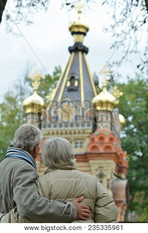 Portrait Of Beautiful Caucasian Senior Couple Looking At Church