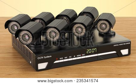System Digital Video Recorder, Cctv On The Wooden Table. 3d Rendering