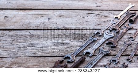 Metal Wrench Rusty Tools Lying On A Black Wooden Table. Hammer, Chisel, Hacksaw, Metal Wrench. Copy