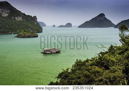 In The Gulf Of Thailand, The Islets Of The Chumphon Archipelago Are Seen, Among Which A Passenger Sh