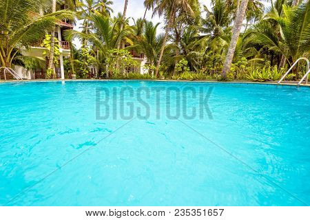 Swimming Pool In Tropical Hotel. Scenic Pool With Blue Water In A Tropic. Idyllic Place To Relax. Cl