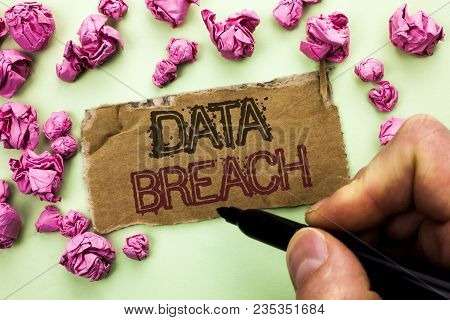 Writing note showing  Data Breach. Business photo showcasing Stolen Cybercrime Information Hacking Security Malicious Crack written by Man Holding Marker Tear Cardboard Piece plain background. poster