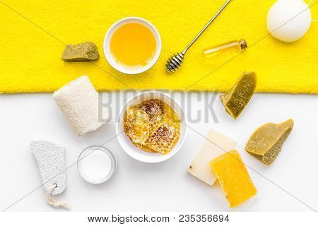 Aromatic theraphy and delicate skin care. Spa set based on honey on white background top view. poster