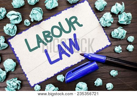 Writing note showing  Labour Law. Business photo showcasing Employment Rules Worker Rights Obligations Legislation Union written Cardboard Piece the wooden background Marker next to it. poster