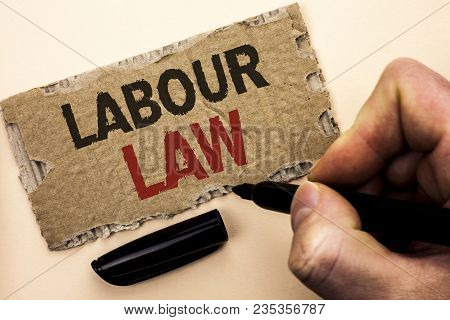 Writing note showing  Labour Law. Business photo showcasing Employment Rules Worker Rights Obligations Legislation Union written by Man Holding Marker tear Cardboard Piece Plain Background. poster