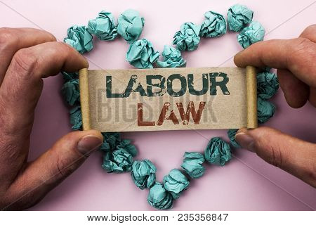 Word writing text Labour Law. Business concept for Employment Rules Worker Rights Obligations Legislation Union written Cardboard Paper Holding by man plain background Heart Paper Balls. poster