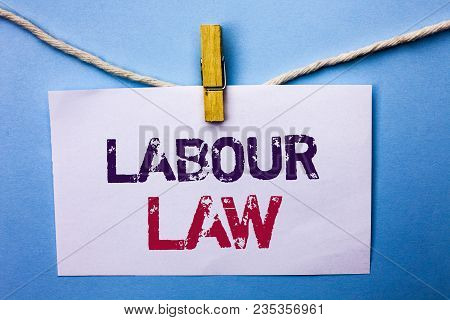 Text sign showing Labour Law. Conceptual photo Employment Rules Worker Rights Obligations Legislation Union written White Note Paper hanging with rope the plain background Clip. poster