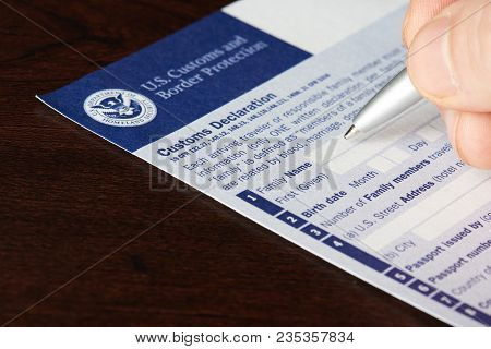 New York, Usa - April 9, 2018: Filling Up Us Customs And Border Protection Form Laying On Wooden Tab