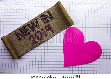 Handwriting text New In 2019. Concept meaning Fresh Era Latest Year Period Season Annual Coming Modern written Cardboard Piece the check background Heart next to it. poster