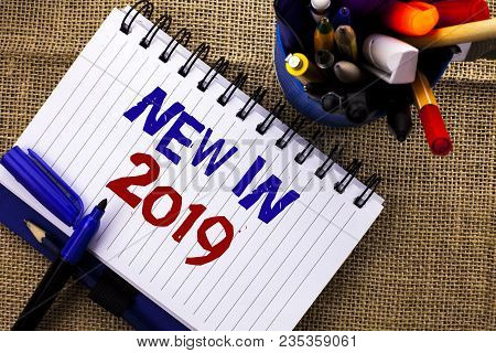Word writing text New In 2019. Business concept for Fresh Era Latest Year Period Season Annual Coming Modern poster