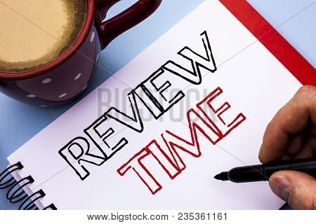 Writing note showing  Review Time. Business photo showcasing Evaluating Survey Reviewing Analysis Checkup Inspection Revision written Notebook Book Holding Pen the plain background Coffee Cup. poster