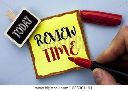 Word writing text Review Time. Business concept for Evaluating Survey Reviewing Analysis Checkup Inspection Revision written by Man Holding Marker Sticky Note Paper the plain background Today poster