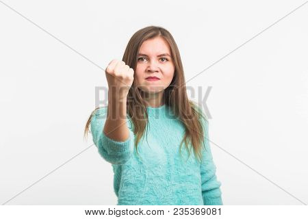 Furious Young Brunette Woman Shows Fist. The Girl Is Very Angry And Ready To Use His Fists. Negative
