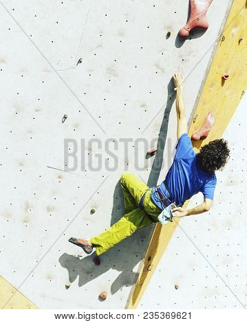 Fitness, Extreme Sport, Bouldering, People And Healthy Lifestyle Concept - Young Man Exercising At I