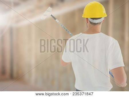Painter on building site