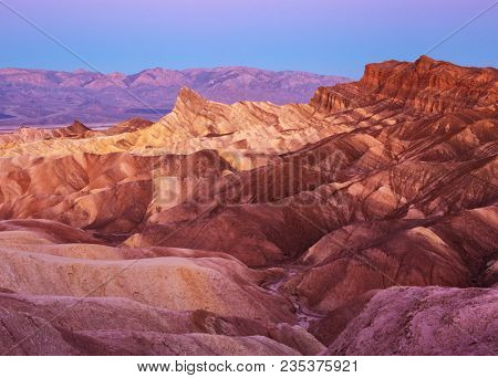 View of Manly Beacon  and Red Cathedral from Zabriskie Point at dawn,  Amargosa Range, Death Valley in Death Valley National Park in California, United States.