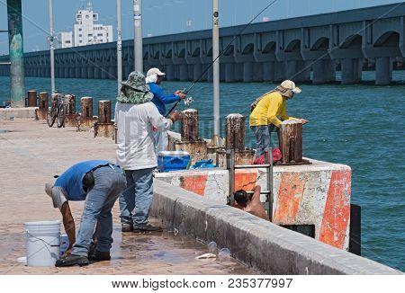 Progreso, Mexico-march 17, 2018: Fisherman On The Fishermans Wharf In Progreso (muelle De Pescadores