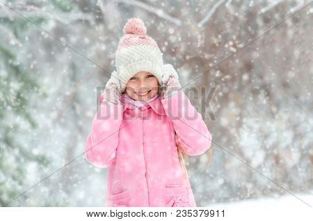 Girl grinning happily in the forest