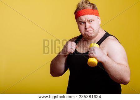 Fat Young Man Boxing And Looking Camera