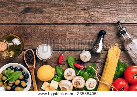 Italian Food Ingredients For The Preparation Pasta On Wooden Background. Top View. Copy Space. Still