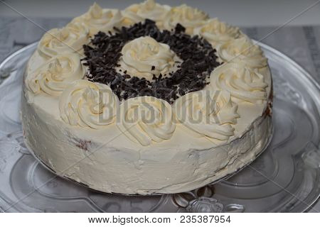 A Cake With White Cream On Table. Whole White Cream Cake With Chocolate And Vanilla Closeup On Glass