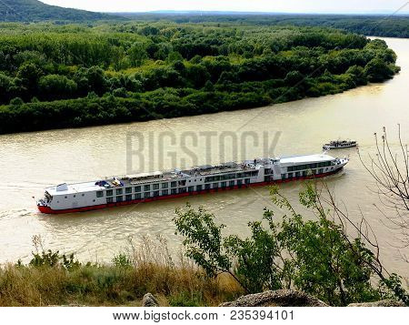 White River Cruise Boat. Cruise Ship Or Boat On Danube River, Slovakia Near Green Forest & Mountains