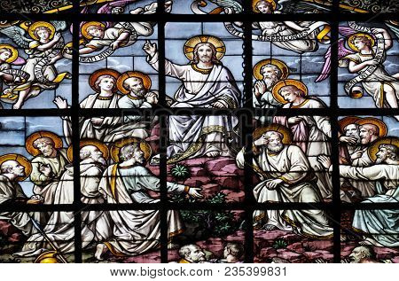 PARIS, FRANCE - JANUARY 05: Jesus in glory and the apostles by Edouard Amedee Didron, stained glass window in Saint Thomas Aquinas in Paris, France on January 05, 2018.