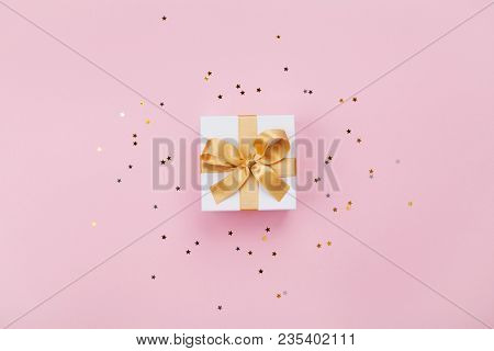 Gift Or Present Box And Stars Confetti On Pink Pastel Table Top View. Flat Lay Composition For Birth