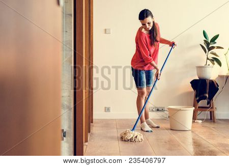 Caucasian woman doing house chores