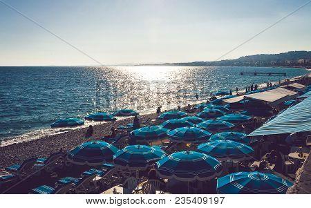 Blue Umbrellas On Beach In Nice