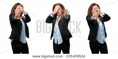 Middle age business woman stressful and shy keeping hand on head, tired and frustrated over white background