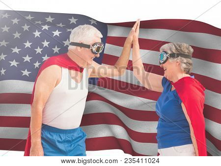 senior people high fiving against american flag