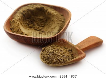 Henna Hair Dye Powder In Bowl With Wooden Scoppn Over White Background