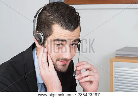 Close Up Callcenter Man With Modern Headset For Customer Service